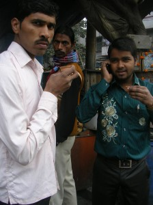 Men drink chai from biodegradable clay cups on the street in Calcutta